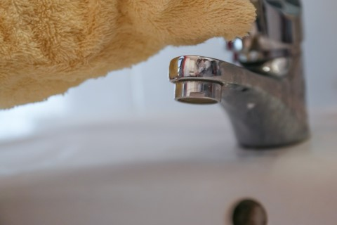 a tap being cleaned