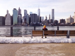 a-man-sits-on-a-bench-in-winter
