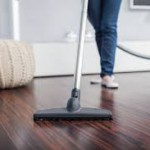vacuuming a hardwood floor
