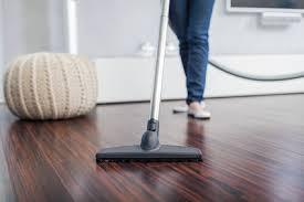 vacuuming a hardwood floor