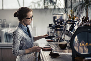 Women with Espresso Machine