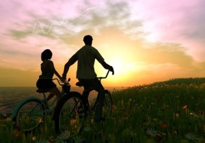a couple on bikes
