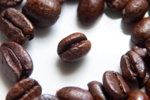 a-coffee-bean-surrounded-by-coffee-beans