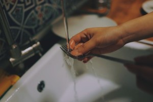 a fork being washed